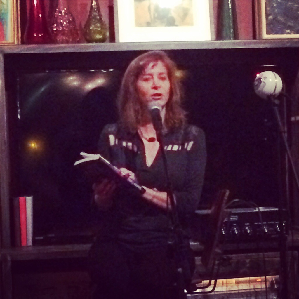 "Dee J. Adams reading from her romantic suspense novel ""Against the Wall"""